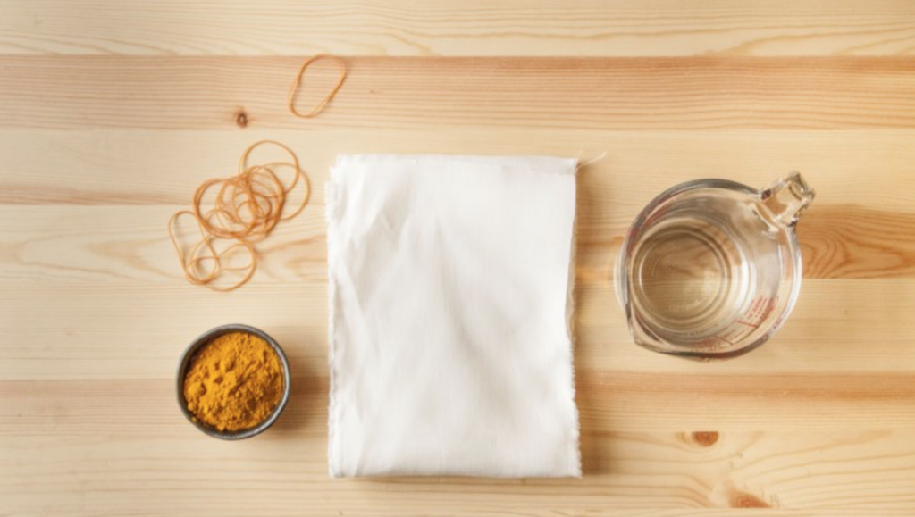 Ollari features image of materials needed to dye fabric with turmeric powder